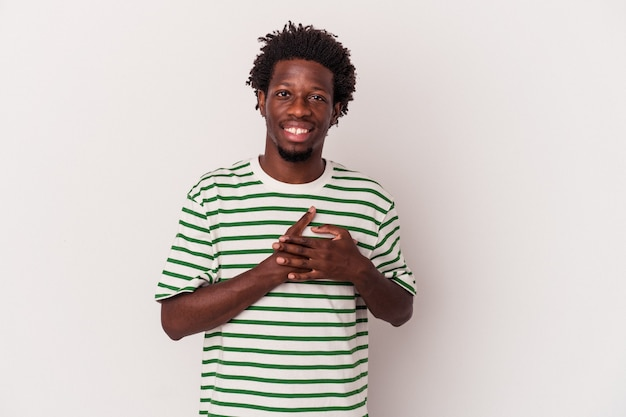 Young african american man isolated on white background  has friendly expression, pressing palm to chest. love concept.