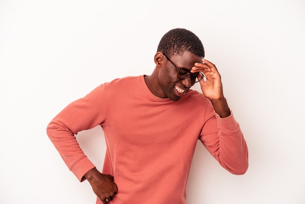 Young african american man isolated on white background joyful laughing a lot. happiness concept.