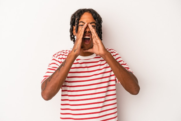 Young african american man isolated on white background shouting excited to front.