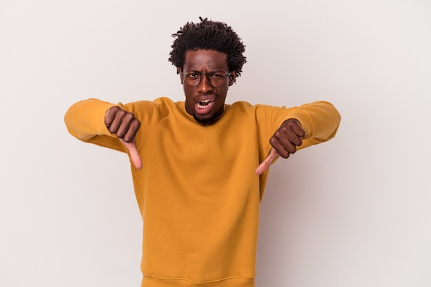 Young african american man isolated on white background  showing thumb down and expressing dislike.