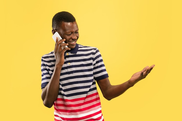 Young african-american man isolated on yellow studio, human emotions concept.