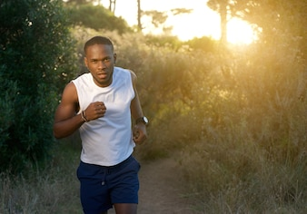 Young african american man running outdoors