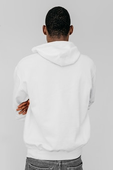 Young african american man wearing a white hoodie