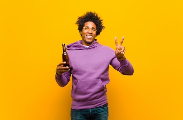 Young african american man with a beer