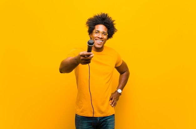 Young african american man with a microphone singing