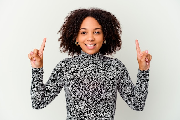 Young african american mixed race woman isolated indicates with both fore fingers up showing a blank space.