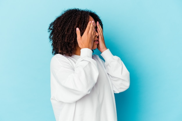 Young african american mixed race woman isolated showing thumb down, disappointment concept.