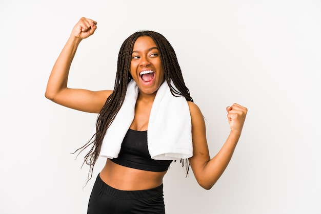 Young african american sport woman raising fist after a victory