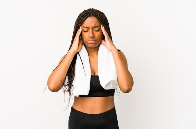 Young african american sport woman touching temples and having headache.