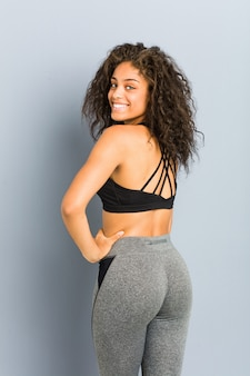 Young african american sporty woman posing