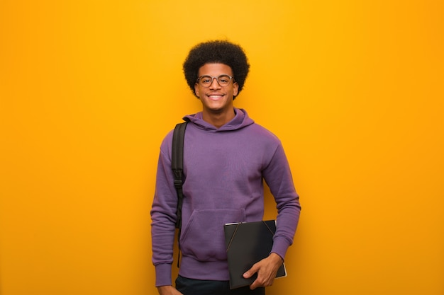 Young african american student man cheerful with a big smile