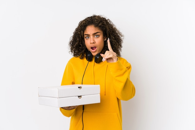 Young african american student woman holding pizzas having an idea