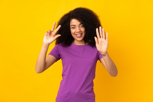 Young african american woman counting eight with fingers
