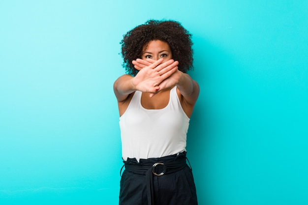 Young african american woman doing a denial gesture