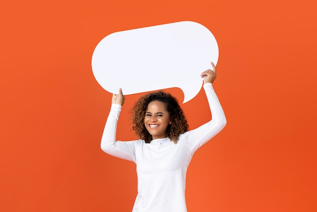 Young african american woman holding empty speech bubble
