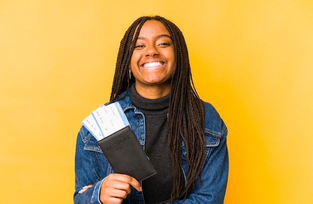 Young african american woman holding a passport