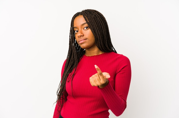 Young african american woman isolated pointing with finger at you as if inviting come closer.