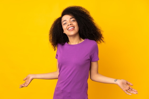 Young african american woman over isolated wall happy and smiling
