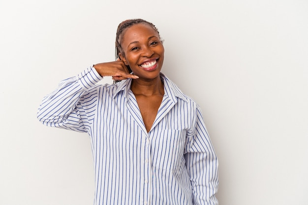 Young african american woman isolated on white background showing a mobile phone call gesture with fingers.