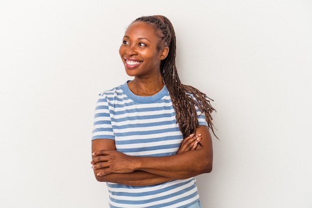 Young african american woman isolated on white background smiling confident with crossed arms.