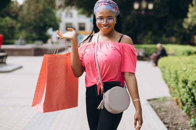 Young african american woman on the street with shopping bags