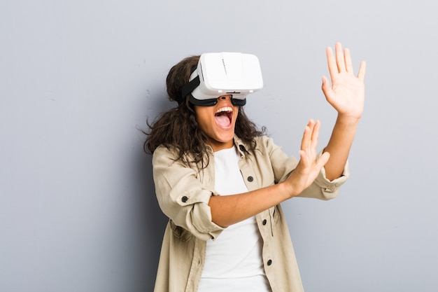 Young african american woman using a virtual reality glasses