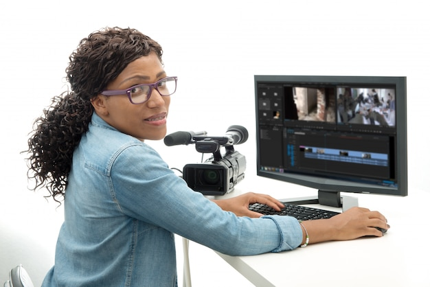 Young african american woman video editor