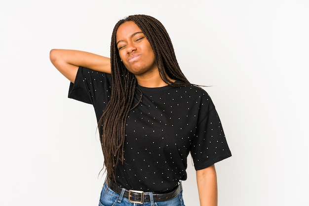 Young african american woman on white wall suffering neck pain