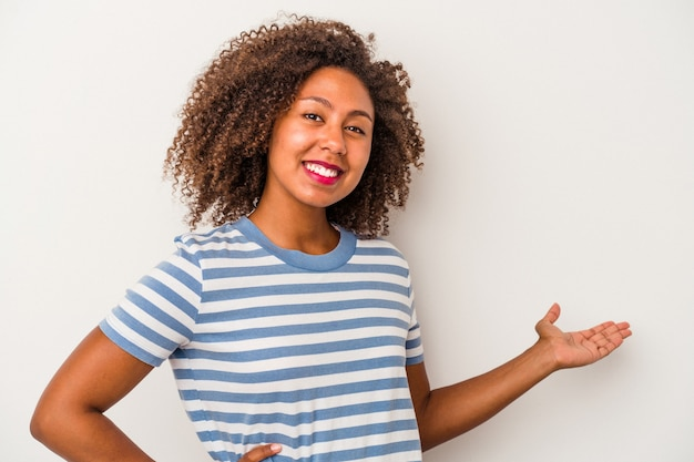 Young african american woman with curly hair isolated on white background showing a welcome expression.