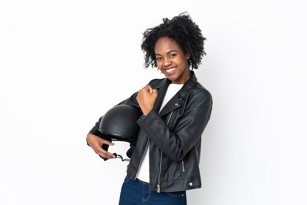 Young african american woman with a motorcycle helmet isolated on white