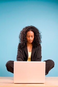 Young african american woman working on laptop