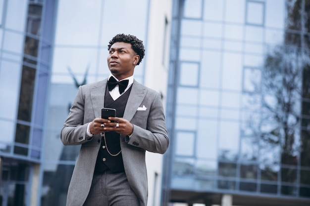 Young african businessman using phone