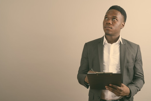 Young african businessman wearing suit