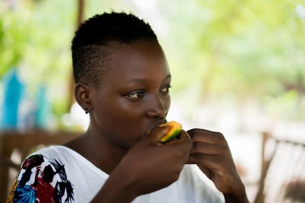 Young african girl in resort having breakfast
