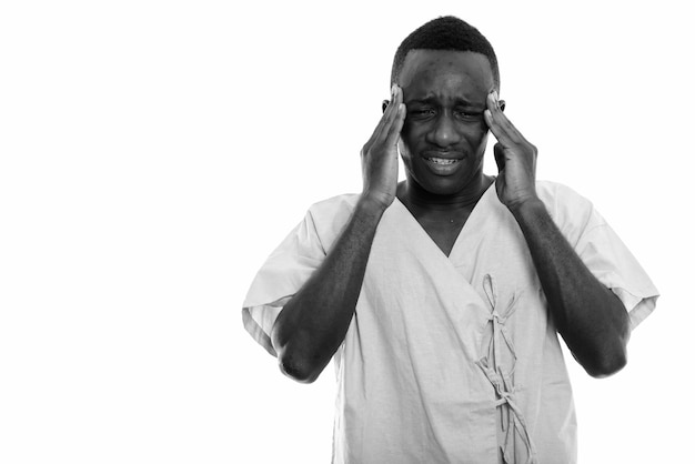 Young african man as hospital patient isolated against white wall in black and white