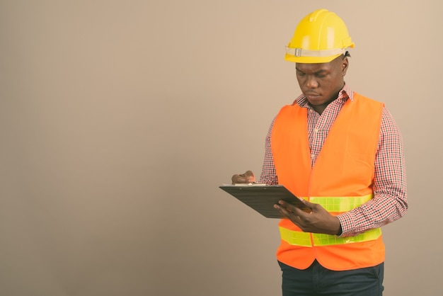 Young african man construction worker