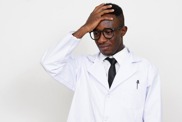 Young african man doctor isolated against white space