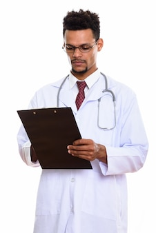 Young african man doctor reading on clipboard isolated on white