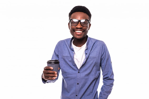 Young african man holding coffee cup isolated on white wall