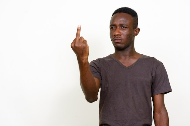 Young african man isolated against white space