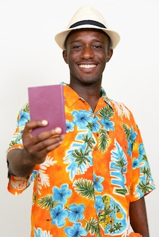 Young african tourist man with hat ready for vacation isolated against white space