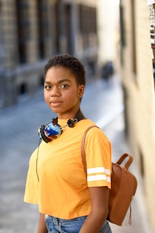 Young african woman wearing casual clothes and headphones