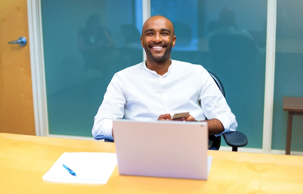 Young afro american businessman in the office with his laptop