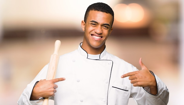 Young afro american chef man proud and self-satisfied in love yourself