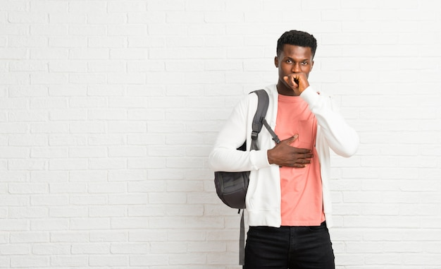 Young afro american man student is suffering with cough and feeling bad