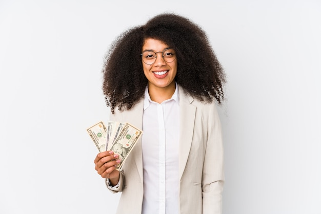 Young afro business woman holding a credit car happy, smiling and cheerful.