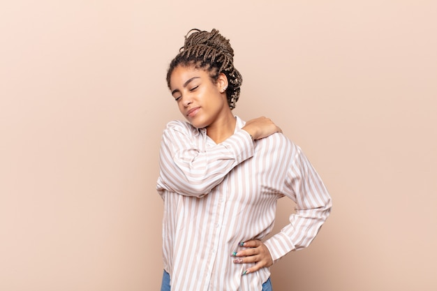 Young afro woman feeling tired, stressed, anxious, frustrated and depressed, suffering with back or neck pain