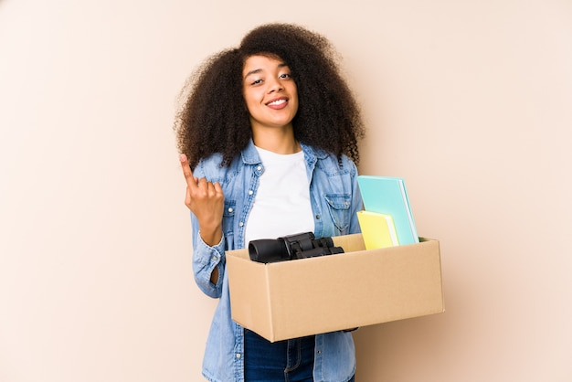 Young afro woman moving home isolated
