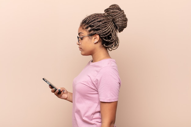 Young afro woman on profile view looking