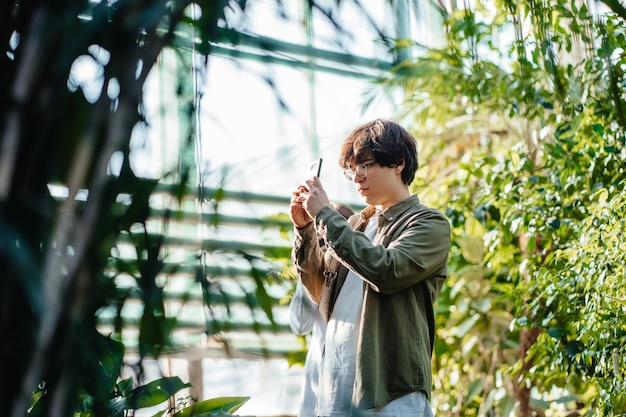Young agricultural engineer working in greenhouse